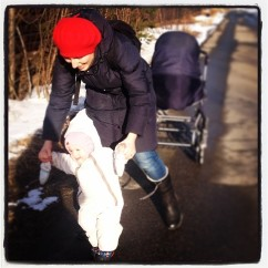 Masha and her stepdaughter go for a walk near their home in Petrozavodsk, 2014. (Photo by C. Hartblay).