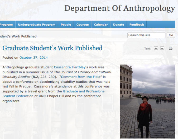 A screen shot from the UNC-CH Department of Anthropology blog shows a short blurb about Cassandra and a photo of her standing in a wool coat near the Prague Castle
